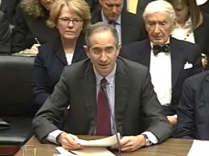 Comcast CEO Brian Roberts, flanked by his father (right), company founder Ralph Roberts.